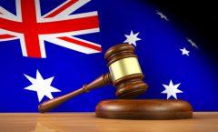 Gavel in front of an Australian flag.