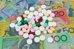 Pills on AUD Dollars Background