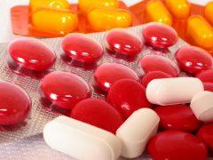 Orange and red pills.