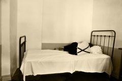 A depressed man on bed in a mental hospital.