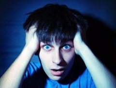 Scared or Shocked Boy Face on Blue Background