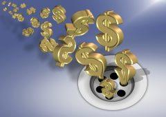 golden dollar symbols going down a sink drain