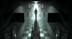 Person Walking Down Dimly Lit Hallway