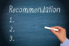 "Blackboard with the word ""recommendation"" on it."