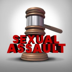 Sexual assault concept and rape crime symbol as a legal court judge mallet hitting a three dimensional text as an icon of sex violence harassment and criminal physical contact.