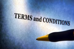 Terms and conditions legal disclosure information notice on a sheet of paper with ballpoint pen