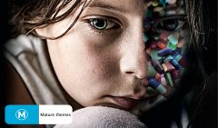 A young girl with half face composed of pills.
