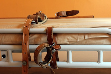 A bed for restraining.