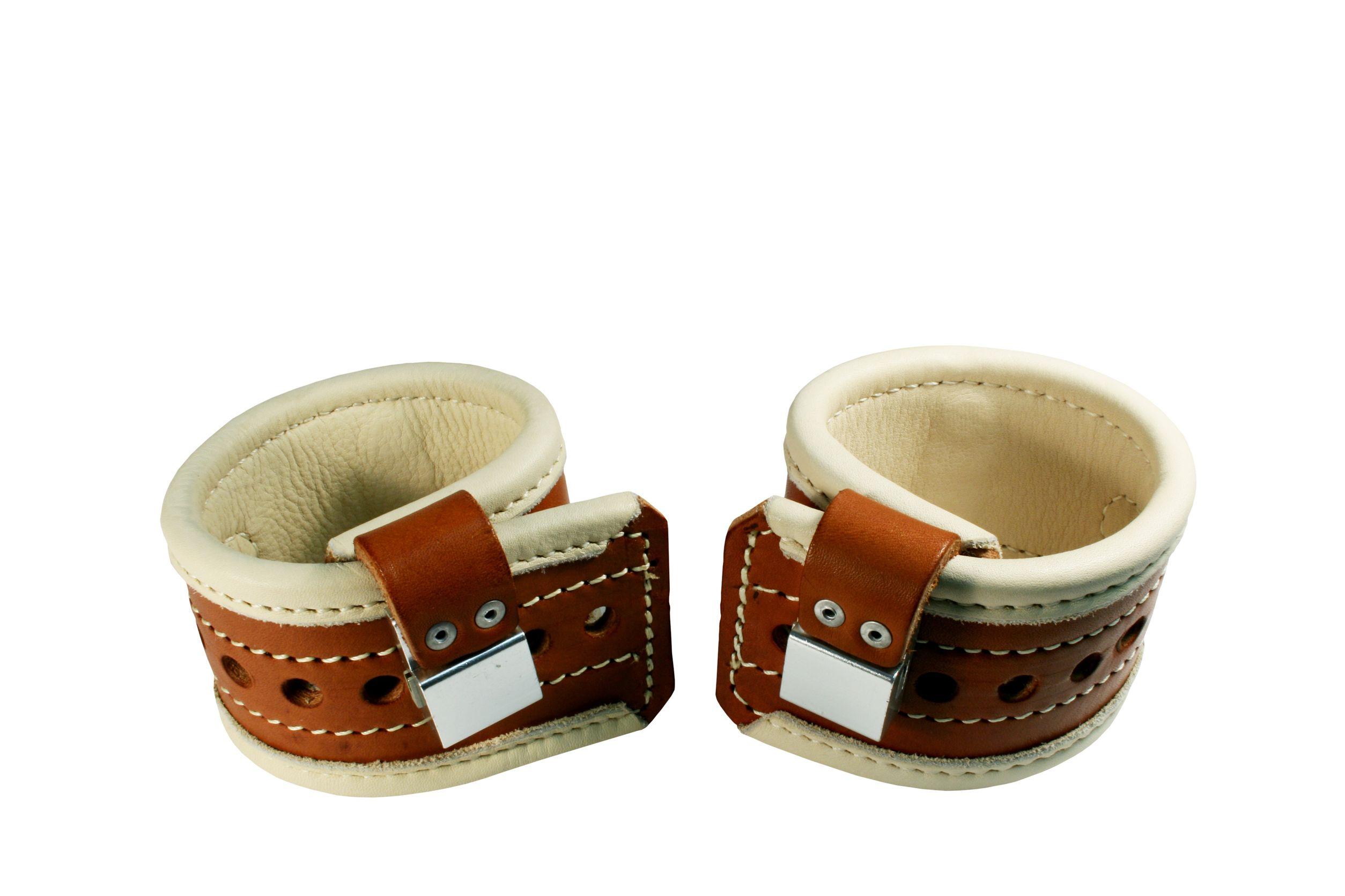 Padded leather wrist restraints.